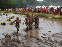 Ladies of the mud. Roanoke County, VA – September 21: Lady runners coming out of the mud pit at the 18th Marine Mud Run on September 21, 2013 in Green Hill Stock Photography