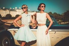 Ladies near classic convertible Stock Photos