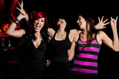 Ladies Night. Three beautiful young women having fun at a nightclub during ladies night Stock Photography