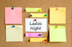 Ladies night sticky note text concept. Colorful sticky notes on cork board background Stock Photo