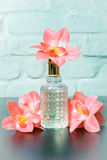 Ladies parfumes with flowers Royalty Free Stock Photo