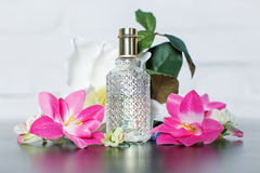 Ladies perfumes with tender flowers Stock Photography