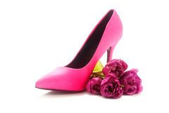 Ladies pink high heel shoe and tulips on white, concept female, royalty free stock photo