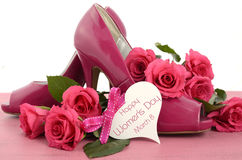 Ladies pink high heel stiletto shoes and roses Stock Images