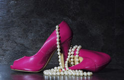 Ladies Pink High Heels With Long Strand Of White Pearls Royalty Free Stock Photo