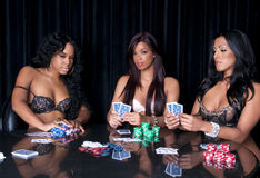 Ladies poker room. Young girls playing poker in lingerie and having fun royalty free stock images