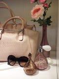 Ladies purse and perfume in wardrobe. Ladies purse and perfume and sunglasses in wardrobe Royalty Free Stock Image