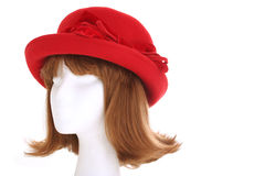Ladies red hat. A 1940s style ladies hat on a mannequin head isolated on white Royalty Free Stock Photography