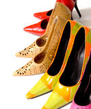 Ladies Shoes. Several pairs of Ladies shoes on white background Stock Photos