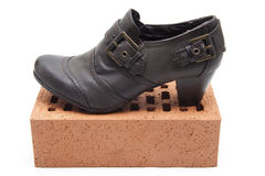 Ladies shoes on brick stone Royalty Free Stock Image