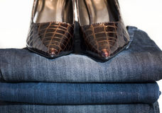 Ladies shoes and Denim jeans Stock Photos