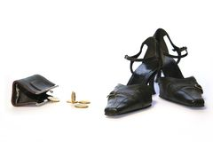 Ladies shoes, purse and coins. Picture of black ladies shoes, purse and golden coins stock photo
