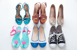 Ladies shoes on wooden background Stock Images