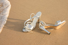Free Ladies Silver Shoes On  A Beach Stock Photos - 32847123