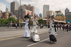 Ladies on stilts on parade Royalty Free Stock Photo