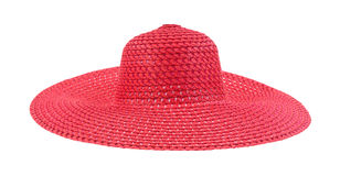 Ladies summer red straw hat. A large floppy red straw hat for ladies on a white background Royalty Free Stock Photography