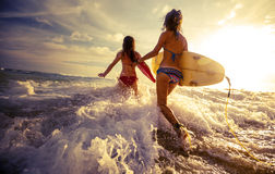 Ladies surfers royalty free stock images