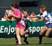 Ladies tackle at the Dubai Rugby Sevens Royalty Free Stock Image