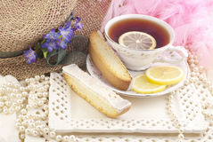 Ladies Tea Party. A beautiful ladies tea party with cup of tea and lemon biscotti Stock Photos