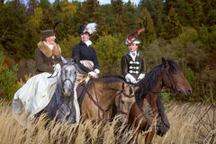 Ladies in 19th century dress riding horses Royalty Free Stock Images
