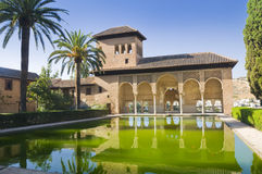 Ladies Tower in Alhambra. A part of the Alhambra called Ladies Tower in Granada, Spain. Reflection in a pool Royalty Free Stock Photography
