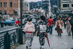 Ladies in traditional Japanese outfits walking the Kyoto streets stock images