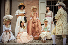Ladies in Victorian dress. While conversing with a man. June 15, 2014, A day in the 700 - Association of Italian Marie Antoinette, Villa Sorra, Castelfranco Stock Photography