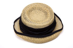 Ladies Vintage hat. Ladies Vintage straw hat from low perspective isolated against white background Royalty Free Stock Images