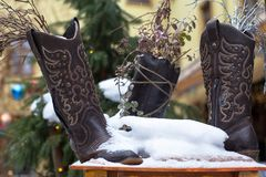 Ladies vintage leather cowboy shoes covered with snow. stock photography