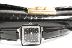 Ladies' watch and handbag Royalty Free Stock Images