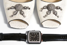 Ladies' watch and high heels shoes Royalty Free Stock Photo