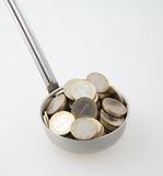 Ladle with coins Stock Photography