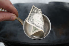 Ladle With Dollar Bill Royalty Free Stock Image