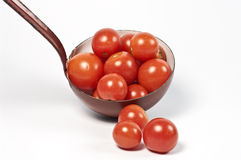 Ladle and fresh tomatos Stock Photos