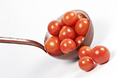 Ladle and fresh tomatos Royalty Free Stock Image