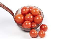 Ladle and fresh tomatos Royalty Free Stock Photo