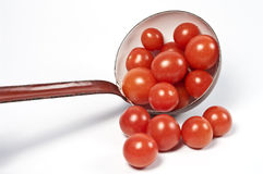Ladle and fresh tomatos Stock Photo
