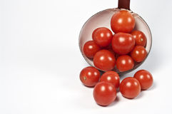 Ladle and fresh tomatos Stock Photography