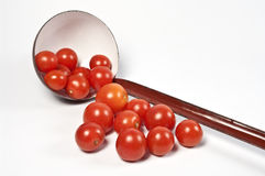 Ladle and fresh tomatos Royalty Free Stock Images