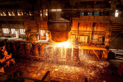 From ladle pours red-hot steel Royalty Free Stock Photo