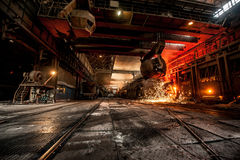 From ladle pours red-hot steel. Martin furnace. Foundry Royalty Free Stock Photography