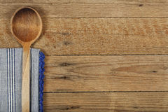 Ladle and tablecloth Stock Images