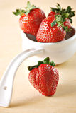 Ladle of Whole Strawberries Stock Image