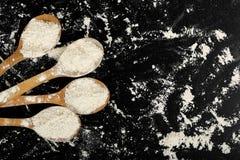 Ladles of flour Royalty Free Stock Image