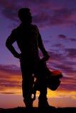 Lado de la mirada de la silla de montar del vaquero del hombre de la silueta Fotos de archivo libres de regalías