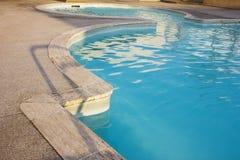 Lado de la piscina en la salida del sol Imagen de archivo libre de regalías