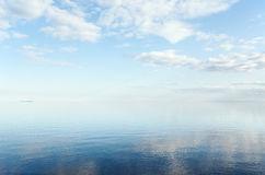 The Ladoga. Lake, the blue sky and reflexion in water Stock Images