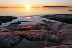 Ladoga kust på soluppgången Fotografering för Bildbyråer
