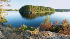 Ladoga lake with island under sunlight Royalty Free Stock Image
