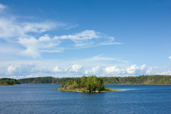 Ladoga lake with small island under sunlight Royalty Free Stock Photography